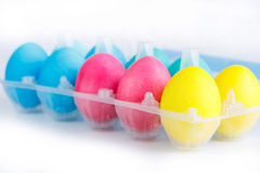 Colorful easter eggs in package isolated. Stock Photography