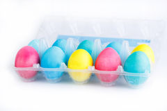 Colorful easter eggs in package isolated. Stock Photos