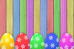 Colorful Easter eggs on painted color wooden texture Royalty Free Stock Image