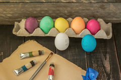 Colorful easter eggs with painting brush on old paper . Ready to Royalty Free Stock Photography