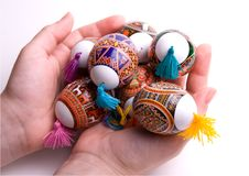 Colorful Easter eggs in palms, isolated. Stock Photography