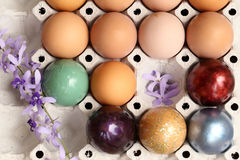 Colorful easter eggs on paper tray Stock Photos