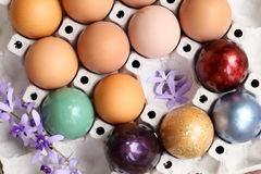 Colorful easter eggs on paper tray Royalty Free Stock Image