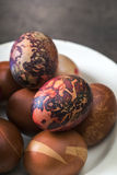 Colorful Easter eggs in plate Stock Photos