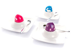 Colorful Easter eggs on plates Royalty Free Stock Images