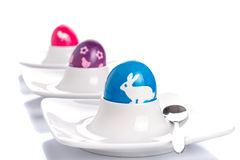 Colorful Easter eggs on plates Royalty Free Stock Photo