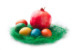 Colorful Easter Eggs with a pomegranate Stock Image