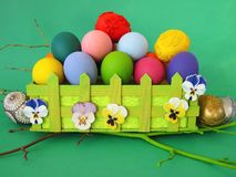 Colorful easter eggs in pouch royalty free stock photography