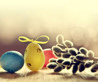 Colorful easter eggs and pussy-willow on grey background. Colorful easter eggs and branches of willow on grey background Stock Photo
