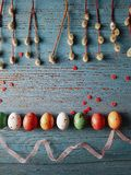 Colorful easter eggs and pussy willow, spring holidays concept. Selective focus, top view, space for text Royalty Free Stock Image