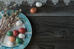 Colorful easter eggs and pussy willow, spring holidays concept. Selective focus, top view, space for text Stock Photos