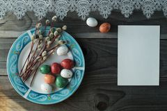 Colorful easter eggs and pussy willow, spring holidays concept. Selective focus, top view, space for text Royalty Free Stock Photos