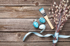 Colorful easter eggs and pussy willow. On wooden table. Top view with copy space Royalty Free Stock Photography