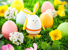 Colorful Easter Eggs and rabbit Stock Photos