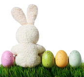 Colorful easter eggs and rabbit on grass, isolated on white Royalty Free Stock Photos