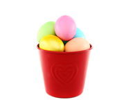Colorful Easter eggs in a red bucket. Royalty Free Stock Images