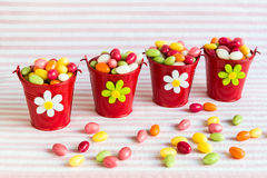 Colorful easter eggs in red buckets. Stock Image