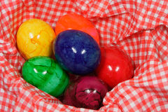 Colorful easter eggs in a red and white napkin. Six colorful eggs in a red and white napkin royalty free stock photography