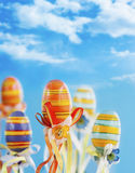 Colorful easter eggs with ribbons stock photography