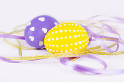 Colorful easter eggs with ribbons. Isolated on white background Stock Photo