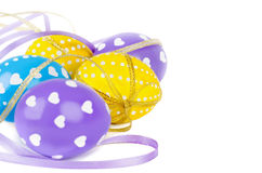 Colorful easter eggs with ribbons. Isolated on white background Royalty Free Stock Image