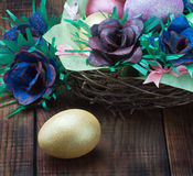 Easter eggs and rose from the egg packaging Stock Image