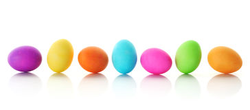 Colorful Easter eggs in a row. Bright, colorful Easter eggs in row, isolated on white Stock Images
