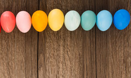Colorful Easter eggs in row stock photo