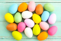 Colorful Easter eggs on rustic wooden planks background. Stock Photography
