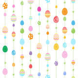 Colorful Easter eggs seamless pattern. Decorative background. Eggs hanging on strings with stars Stock Photos