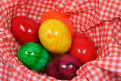 Colorful easter eggs. Sex colorful eggs on a red and white napkin Royalty Free Stock Photos