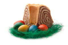 Colorful Easter Eggs with a slovene cake potica Royalty Free Stock Photo