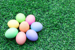 Colorful easter eggs on the soccer field grass Royalty Free Stock Photo