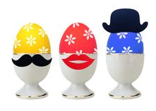 Colorful Easter Eggs in stand isolated on white Stock Photo