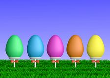 Colorful Easter Eggs on Sticks in Grass Royalty Free Stock Photo