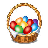 Colorful Easter eggs in straw basket Stock Photos