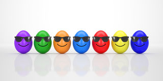 Colorful Easter Eggs with sunglasses smiling Royalty Free Stock Images