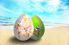 Colorful easter eggs on sunny beach Royalty Free Stock Photos