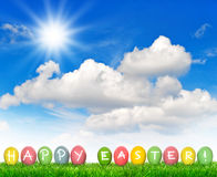 Colorful Easter eggs sunny blue sky. Happy Easter Stock Images