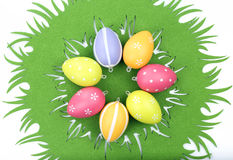 Colorful Easter eggs on tablecloth Stock Photos