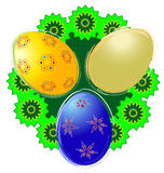 Colorful Easter eggs. Three Easter eggs with green wreath Royalty Free Stock Photos