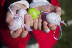 Colorful Easter eggs in toddlers hands Stock Images