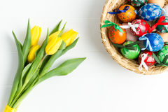 Colorful Easter eggs, traditional decoration for this spring holiday and tulip typical spring flower Stock Photos