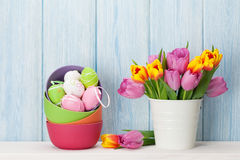 Colorful easter eggs and tulips stock photo