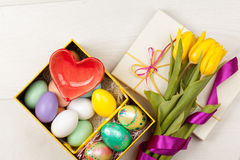 Colorful Easter Eggs and tulips decorated in beautiful giftbox Stock Images