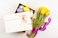 Colorful Easter Eggs and tulips decorated in beautiful giftbox Royalty Free Stock Photo
