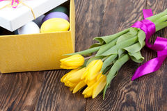 Colorful Easter Eggs and tulips decorated in beautiful giftbox Royalty Free Stock Images