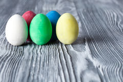 Colorful Easter eggs. Vintage gray wood background. Stock Photo