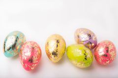 Colorful easter eggs on a white background. Easter concept. Hori. Zontal frame. Happy Easter royalty free stock photo