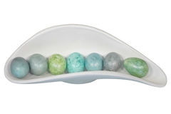 Colorful easter eggs. In a white basket isolated on white background Royalty Free Stock Photo